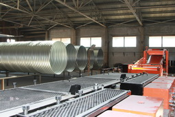 Manufacture of helically corrugated metal pipes