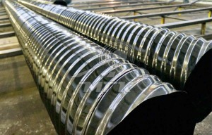 Spiral wound metal corrugated pipes with polymer coating