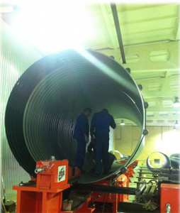 Helically corrugated metal pipes