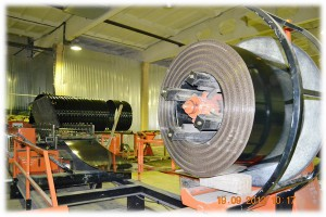Manufacture of coiled spiral coated metal pipes